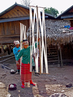 Akha girl, preparing the warp for her mother's loom