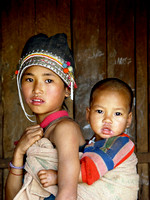 Young Akha girl with younger sibling. Ban Nammat Gao