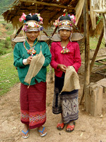 Two young akha women, on their way to the forest