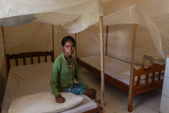 young woman in her bedroom of the TB wing