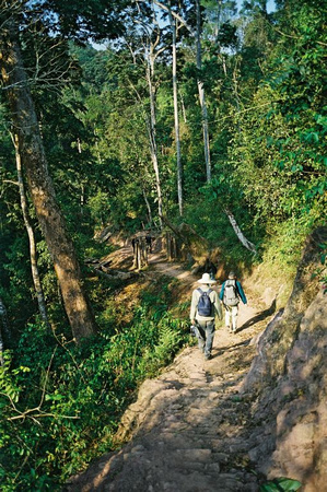 Two 'eco-tourists' leaving Ban Nammat Mai on the last day of the trek